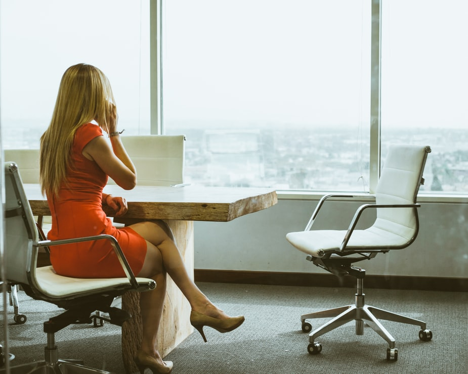 woman making a business call in a conference room