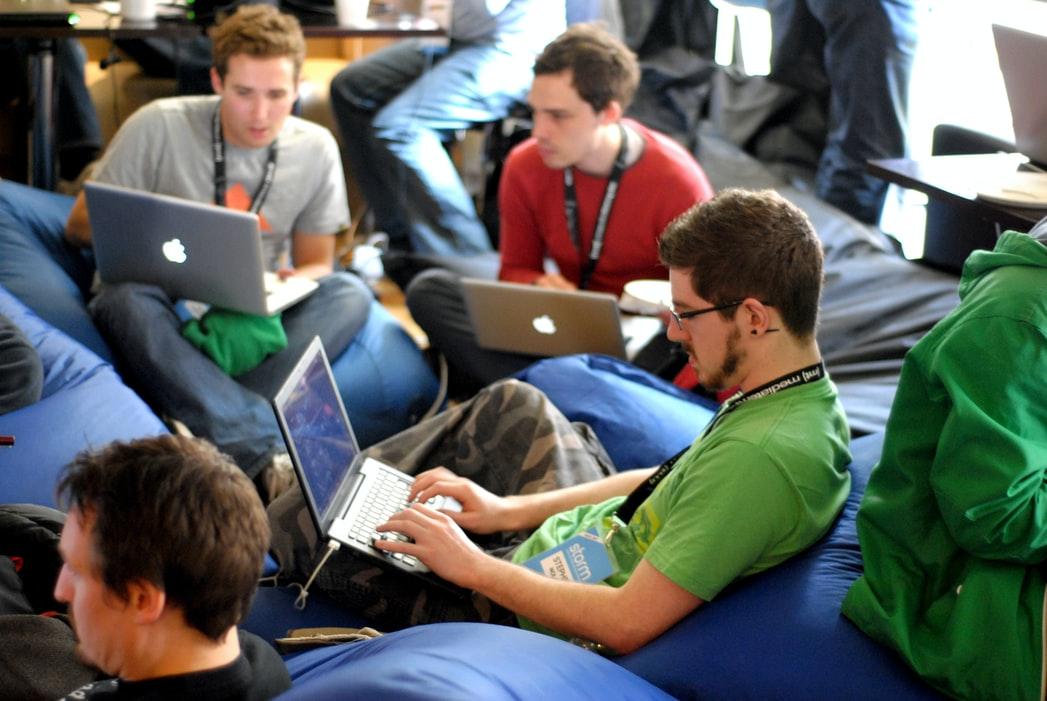 group of men on laptops